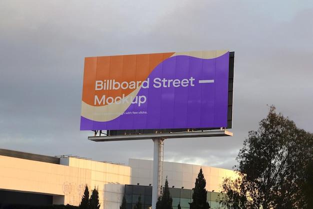 Large billboard mockup on cloudy sky Free Psd