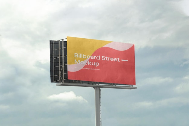 Large billboard mockup on cloudy sky Free Psd