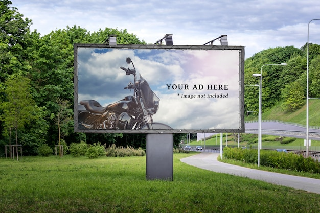 Large commercial advertisement billboard located next to road and sidewalk Premium Psd