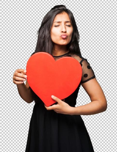 Latin woman holding a heart shape Premium Psd