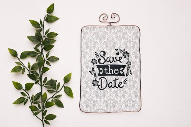 Leaves with vintage save the date mock-up Free Psd