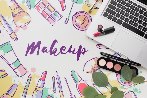 Lipstick and makeup palette on table Free Psd