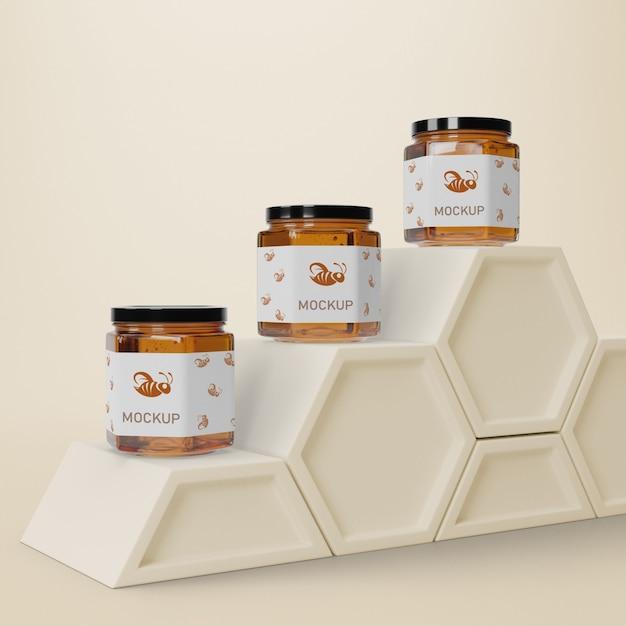 Liquid honey in jars on table Free Psd
