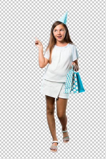 Little girl at a birthday party holding a gift bag standing and thinking an idea Premium Psd