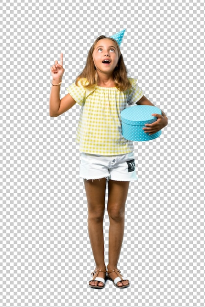 Little girl at a birthday party holding a gift standing and thinking an idea Premium Psd