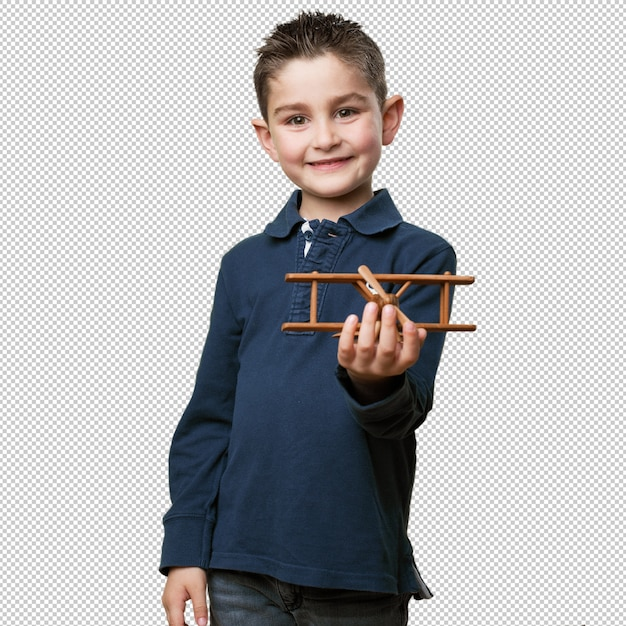 Little kid holding an airplane toy Premium Psd