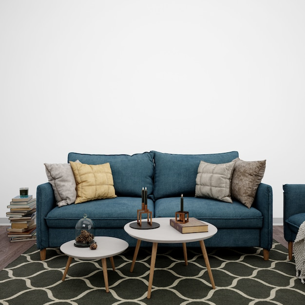 Living room decorated with sofa and books Free Psd