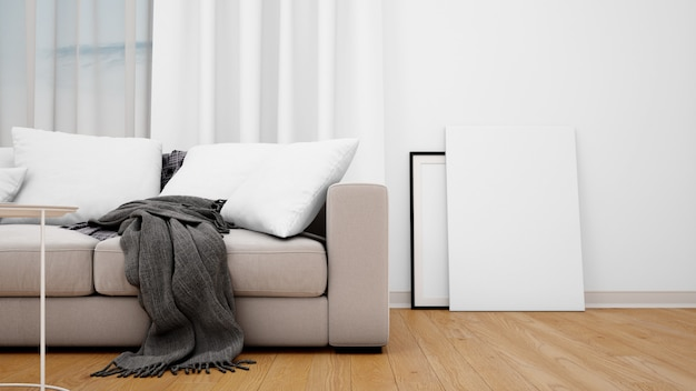Living room with grey sofa and blank canvas or photo frame Free Psd