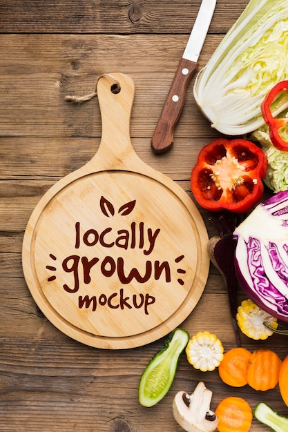 Locally grown veggies mock-up and cutting board Free Psd