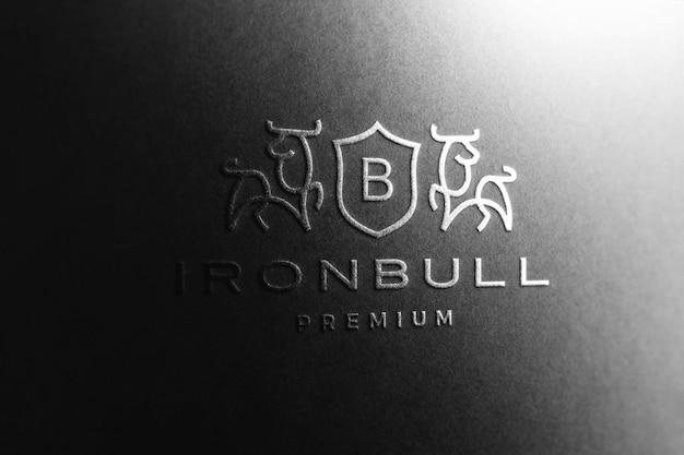 Logo mockup in black paper Free Psd