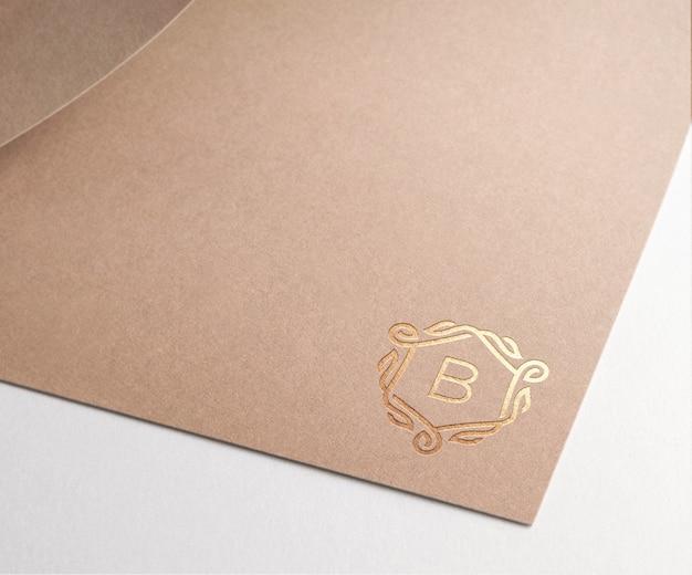 Logo mockup brown paper gold Free Psd
