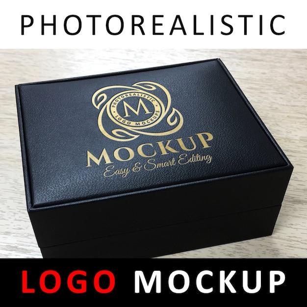 Logo mockup - debossed golden logo on black jewelry leather box Premium Psd