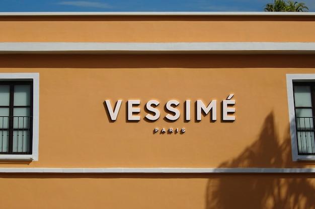 Логотип мокап современное оранжевое здание знак Бесплатные Psd