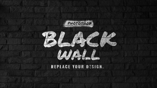 Макет логотипа на черной кирпичной стене Premium Psd