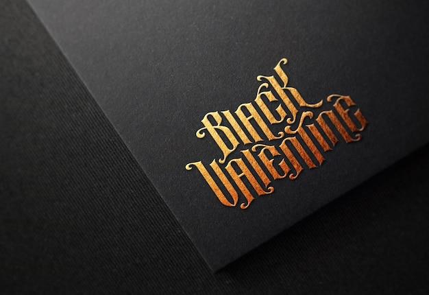 골드 양각 효과와 검은 종이에 로고 이랑 프리미엄 PSD 파일