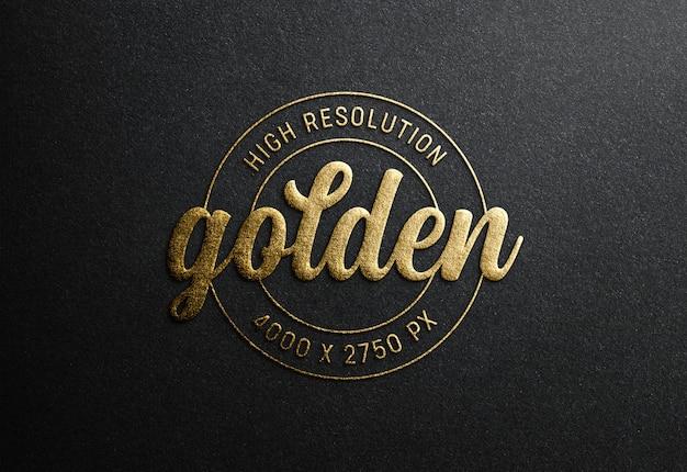 Макет логотипа на черной бумаге с эффектом тиснения золотом Premium Psd