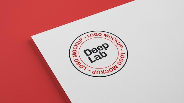 Логотип на белой бумаге с редактируемой стеной макет psd Premium Psd
