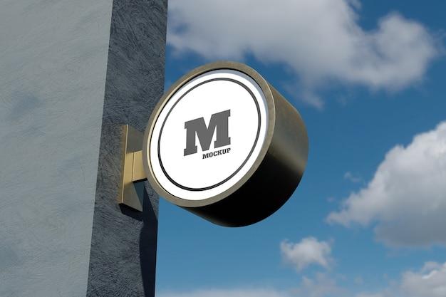 푸른 하늘이있는 외관에 로고 사인 모형 현대 원형 원형 간판 프리미엄 PSD 파일