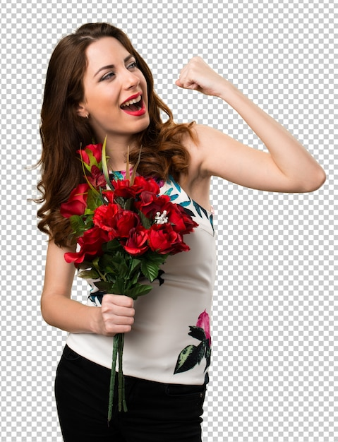 Lucky beautiful young girl holding flowers Premium Psd