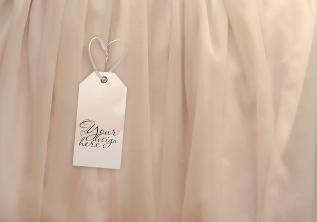 Luggage tag on the background of light beige fabric Premium Psd