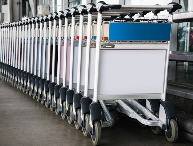 Luggage trolley at the airport with sign mockup Free Psd
