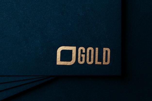 Роскошный золотой логотип макет на крафт-бумаге Premium Psd