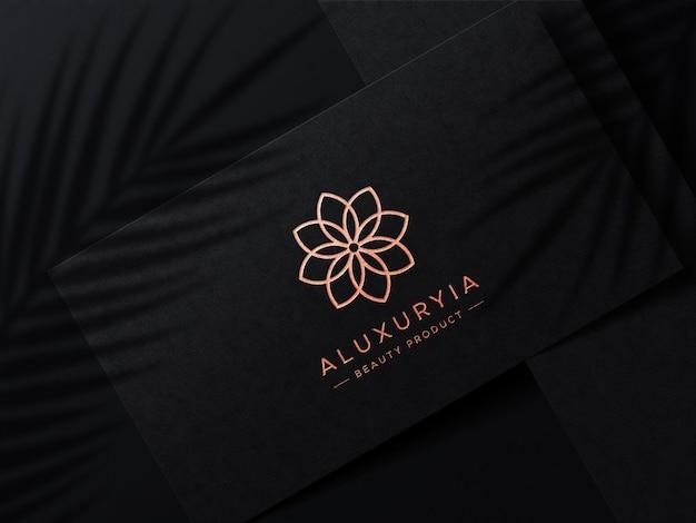 Luxury logo mockup on business card with shadow overlay Premium Psd