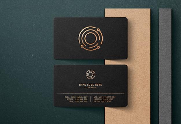 Роскошный логотип макет на черной визитной карте Premium Psd