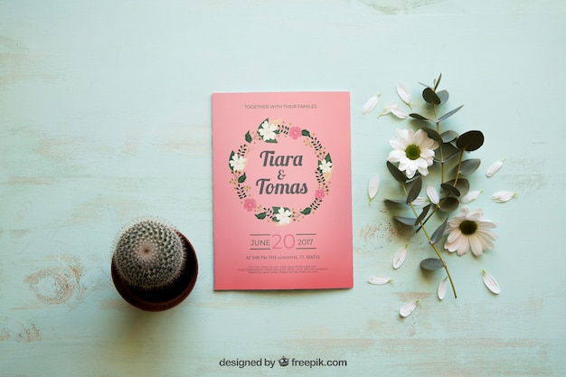 Magazine mockup with cactus and flowers Free Psd