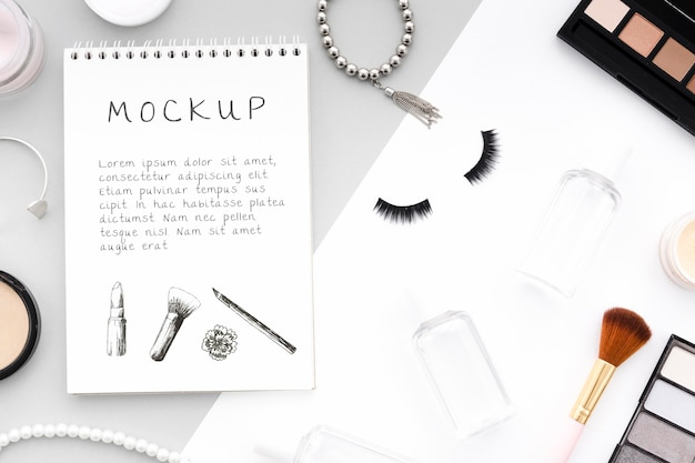 Make-up cosmetics assortment with notepad mock-up Free Psd