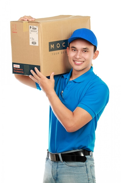 Man delivery service with mockup package isolated on white Premium Psd
