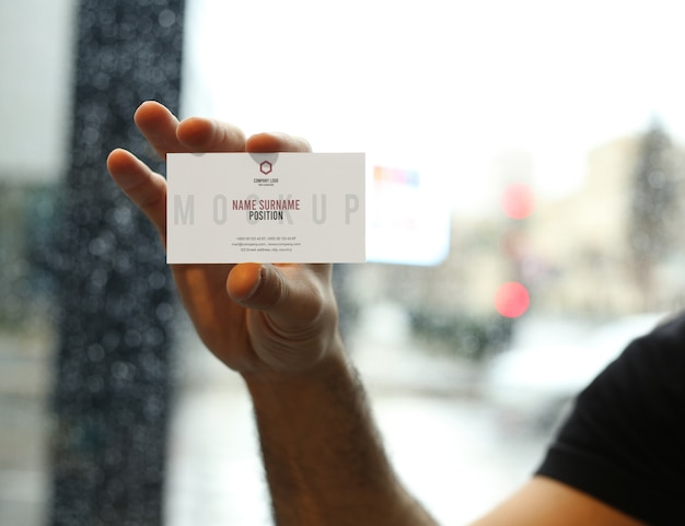 Man hand holding business card mockup psd Premium Psd