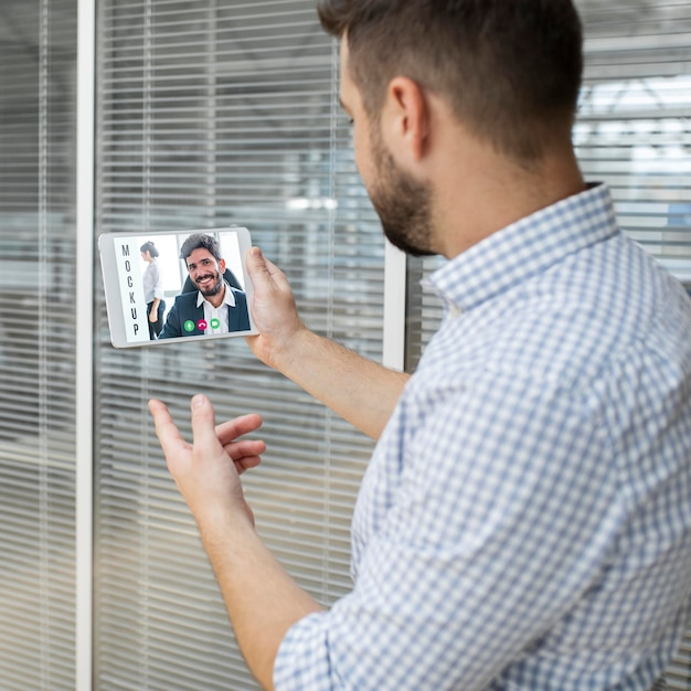 Man having a video conference at work Free Psd