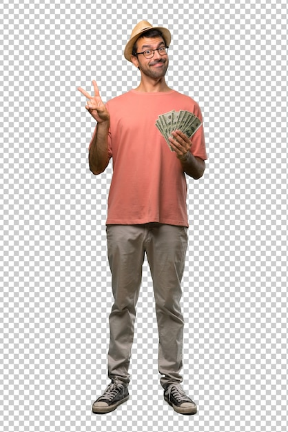 Man holding many bills smiling and showing victory sign with a cheerful face Premium Psd