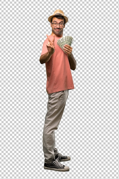 Man holding many bills smiling and showing victory sign Premium Psd