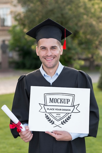 Man holding proudly a mock-up diploma Free Psd