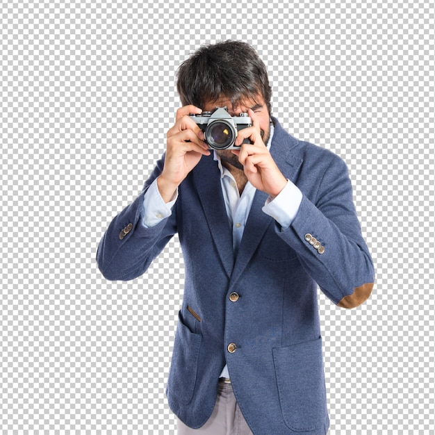 Man photographing over white background Premium Psd