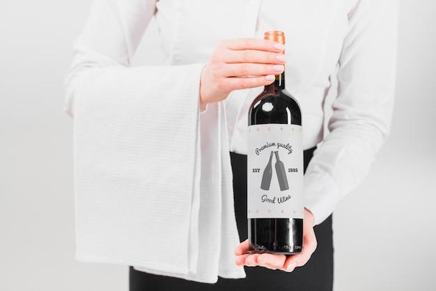 Man presenting wine bottle Free Psd