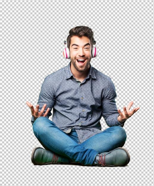 Man sitting on the floor listening to music Premium Psd