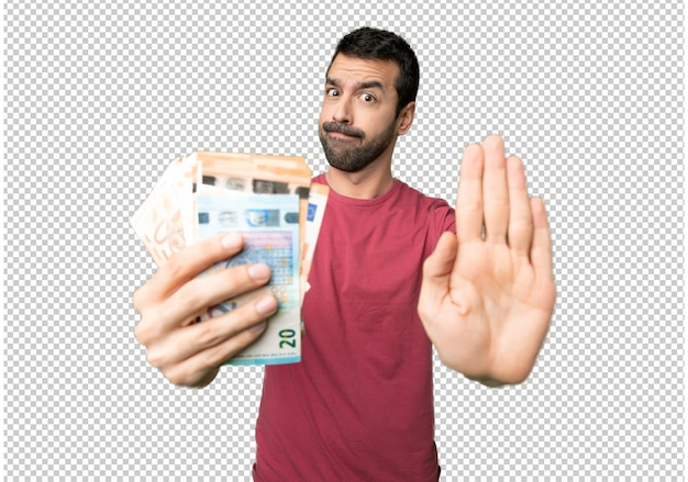 Man taking a lot of money making stop gesture for disappointed with an opinion Premium Psd