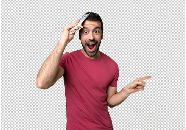 Man taking a lot of money pointing finger to the side and presenting a product Premium Psd