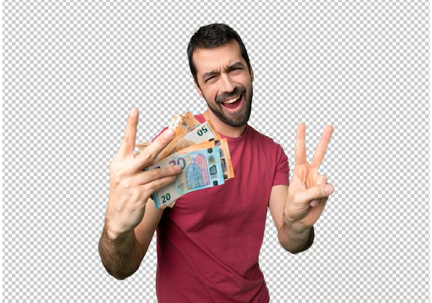 Man taking a lot of money smiling and showing victory sign with both hands Premium Psd