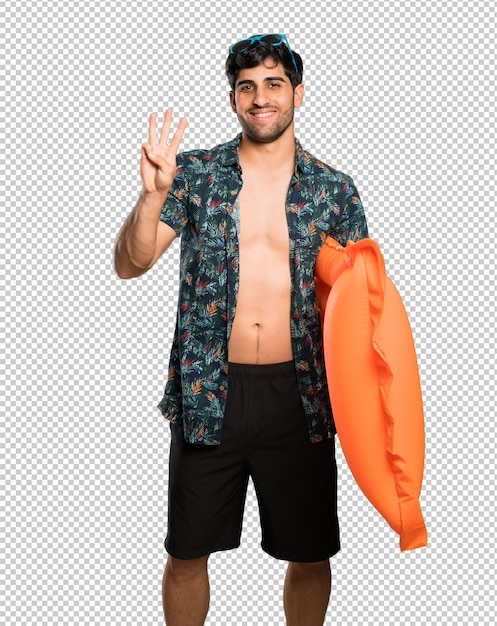 Man in trunks happy and counting three with fingers Premium Psd