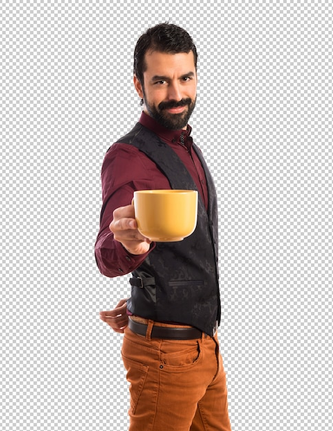 Man wearing waistcoat holding a cup of coffee Premium Psd