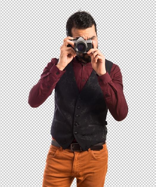 Man wearing waistcoat photographing Premium Psd