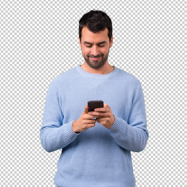Man with blue sweater using mobile phone Premium Psd