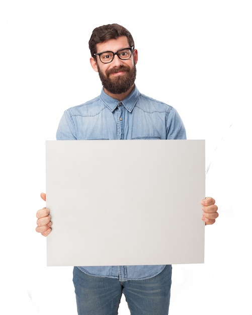 Man With Denim Shirt Holding A Blank Sign PSD File