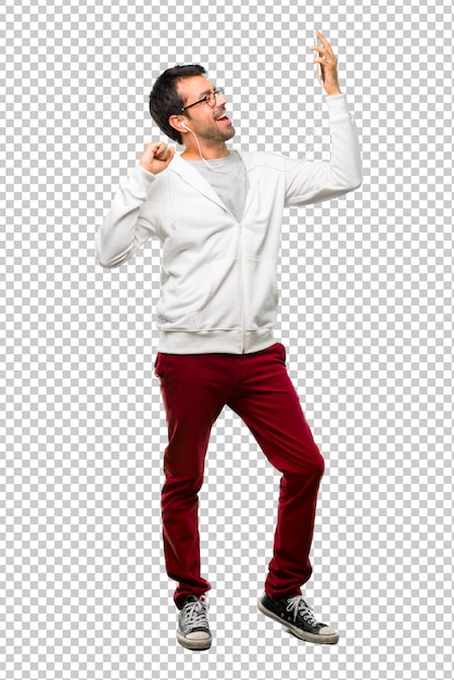 Man with glasses and listening music enjoy dancing while listening to music at a party Premium Psd