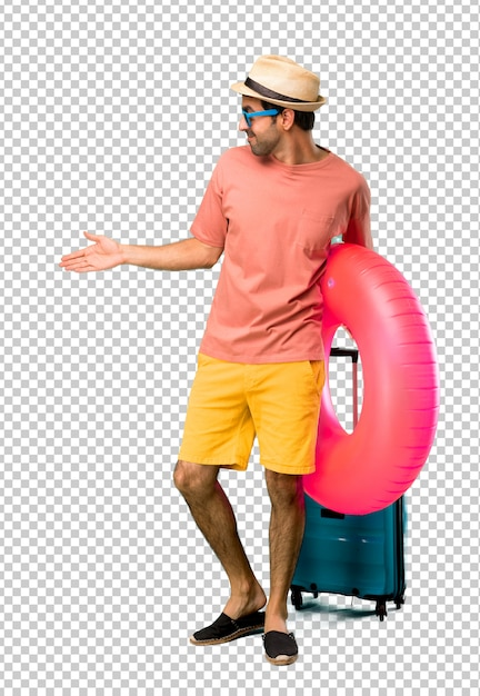 Man with hat and sunglasses on his summer vacation handshaking after good deal Premium Psd