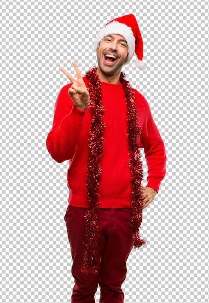 Man with red clothes celebrating the christmas holidays smiling and showing victory sign Premium Psd